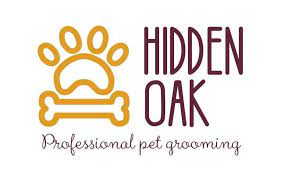 Outline of a dog paw and bone. Hidden Oak Professional Pet Grooming logo