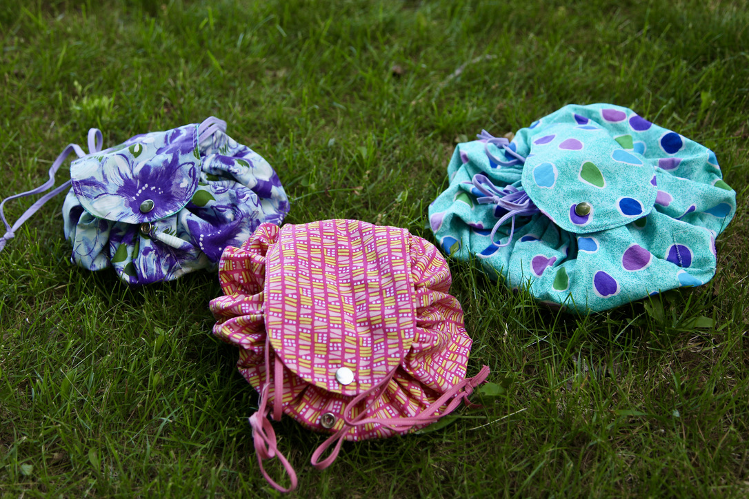 Three Catch-all bags one in each colour: purple, pink and green