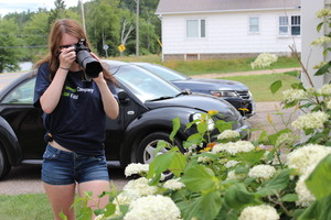 Sydney at work taking photos of flowers